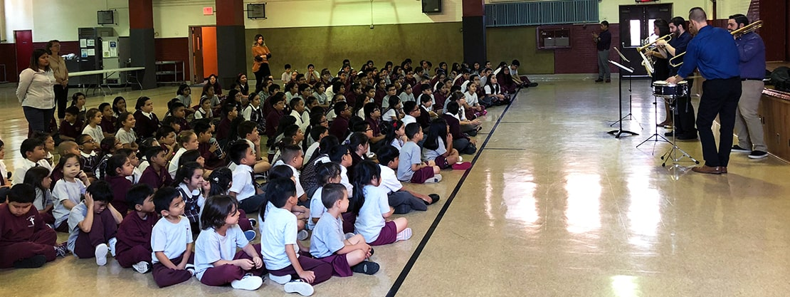 students at music assembly