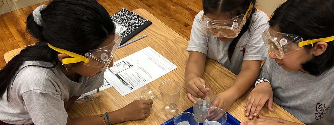 students participating in science lab